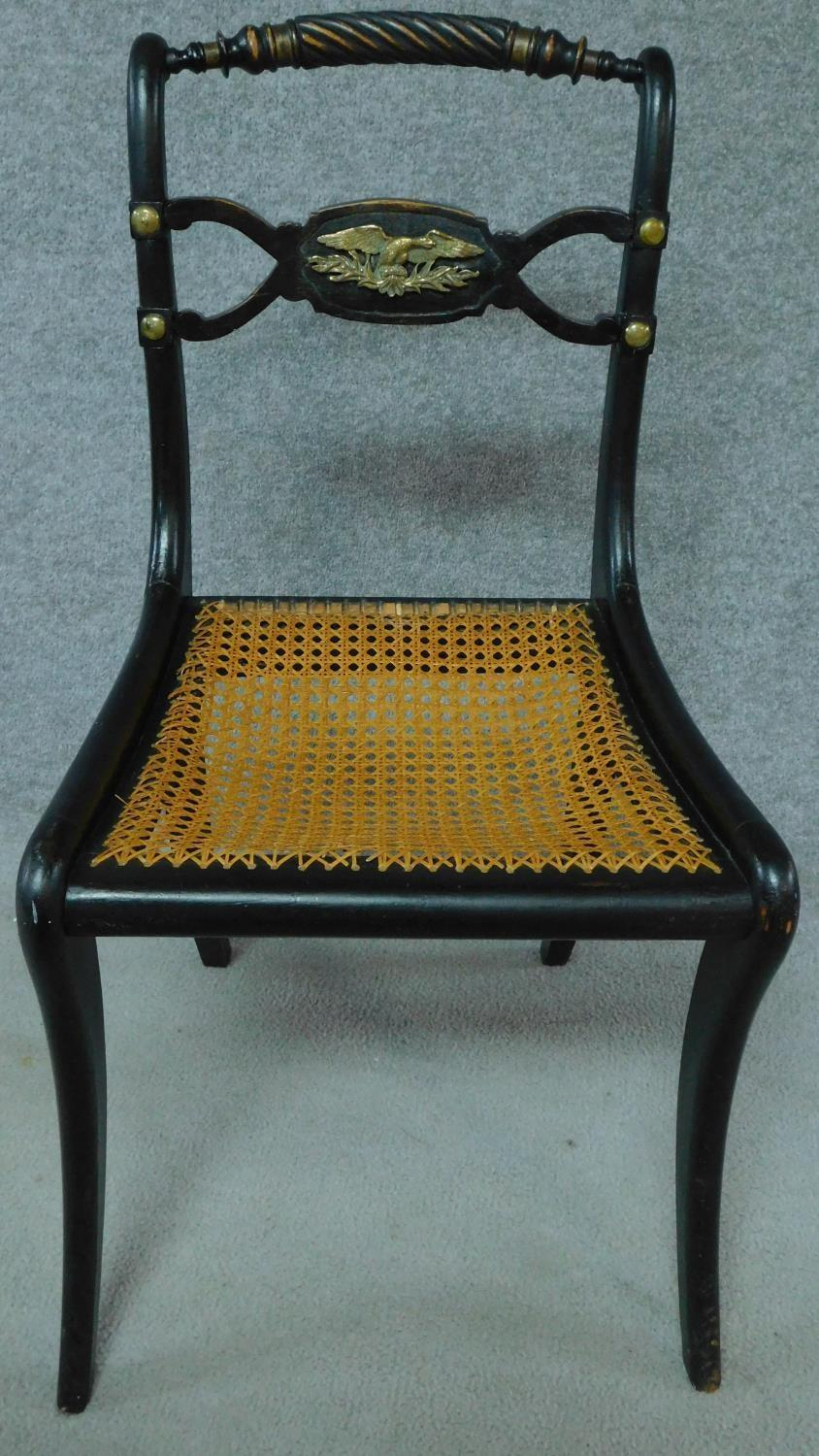 A pair of Regency ebonised caned seated chairs with rope twist top rails and brass eagle motifs, - Image 2 of 7