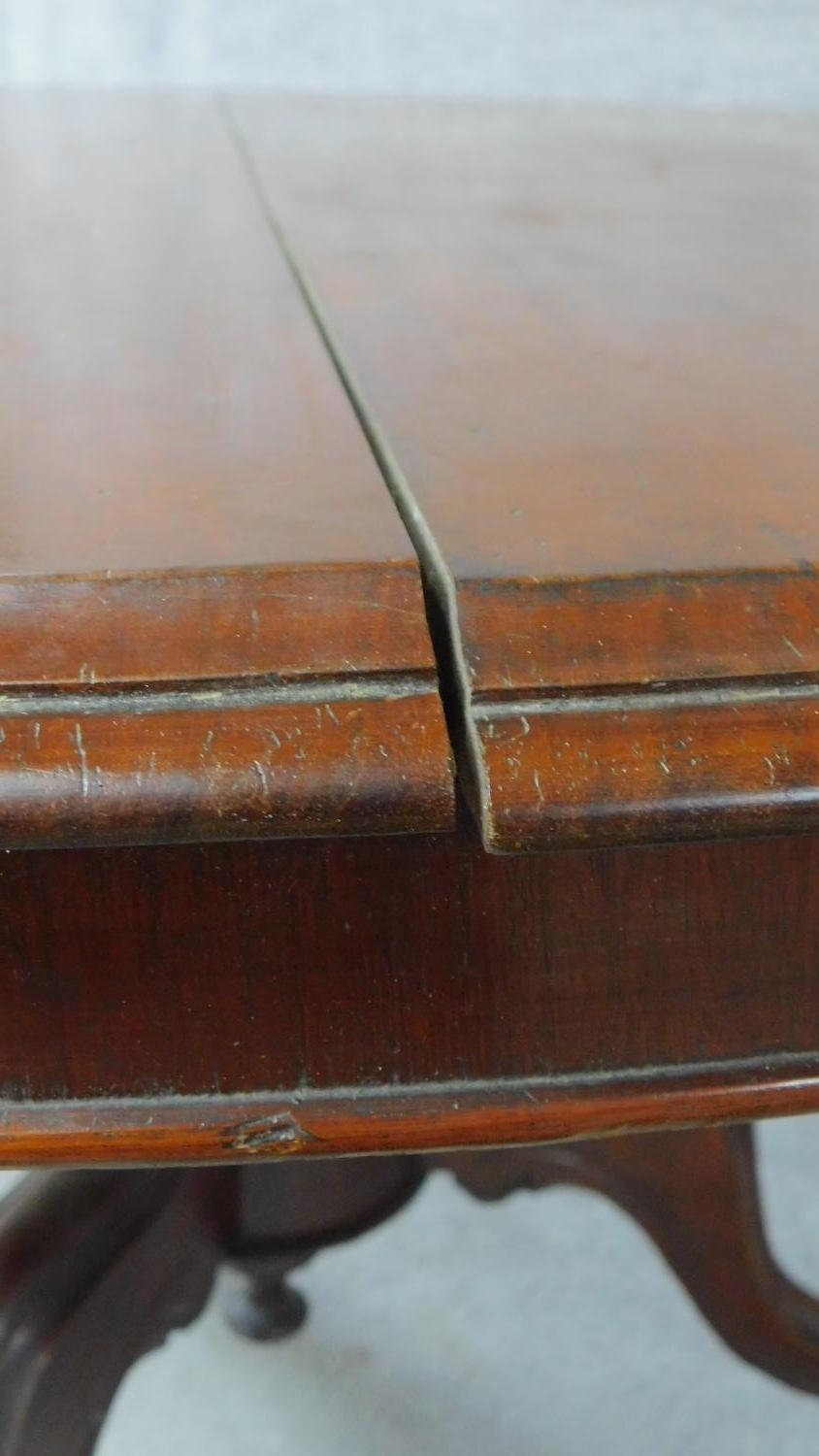 A Victorian mahogany circular dining table with tilt top action raised on carved tripod supports. - Image 6 of 7