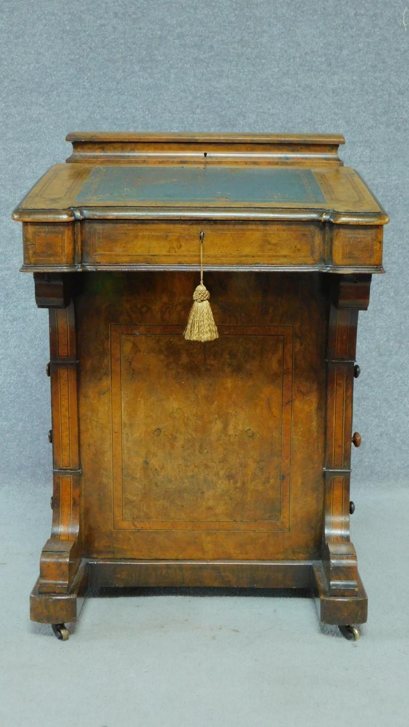 A mid Victorian walnut and satinwood inlaid Davenport with green leather top enclosing fitted