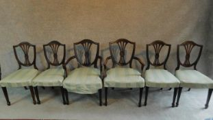 A set of six mahogany Hepplewhite style dining chairs in green striped upholstery raised on square