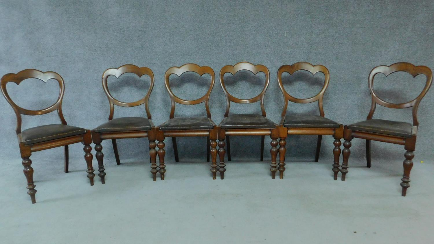 A set of six mid Victorian mahogany shaped back dining chairs raised on bulbous turned supports.