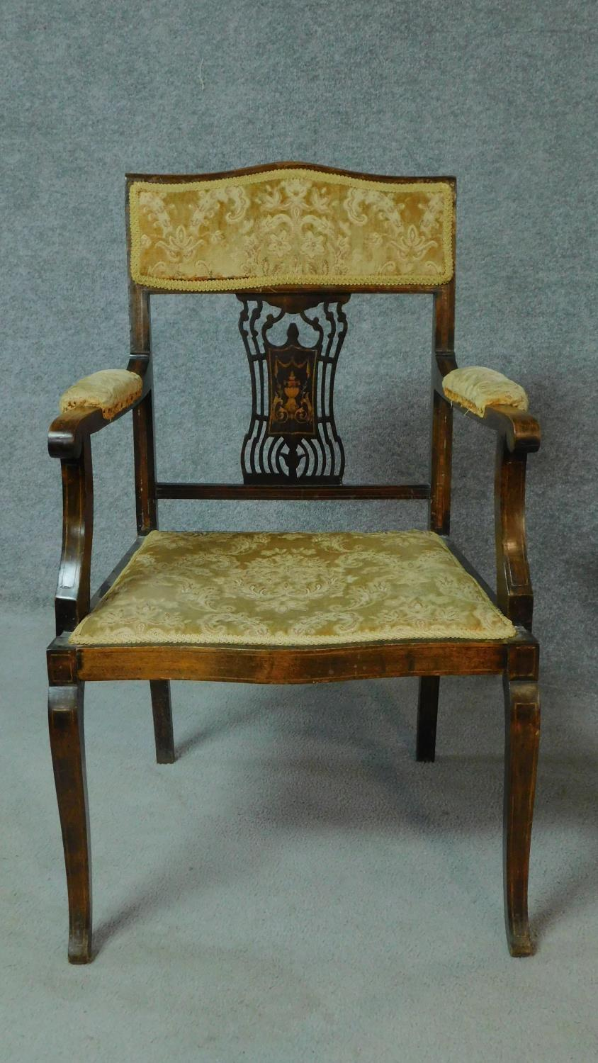 A late Victorian mahogany and satinwood inlaid armchair with urn design to the back, floral