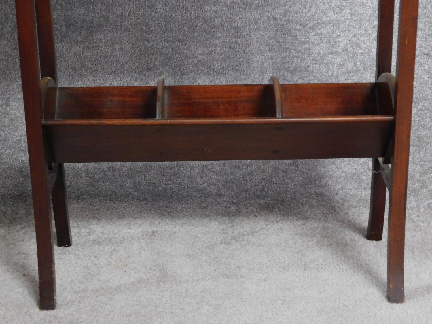 A late Victorian mahogany book trough with under tier, raised on square stretchered swept - Image 4 of 4