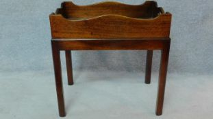 A Georgian style mahogany butler's tray on stand. H.72 W.73 D.49cm