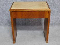 An Art Deco figured walnut piano stool with hinged lift up top enclosing sheet music compartment.