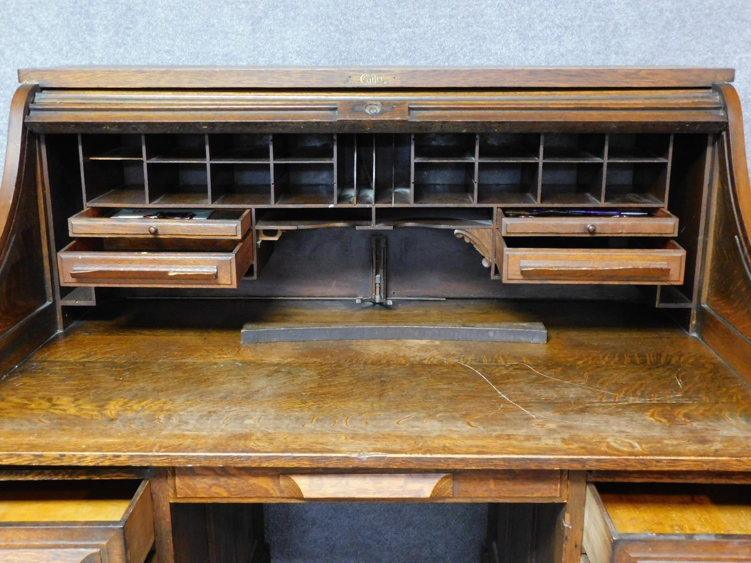 A late 19th century oak roll top desk with tambour shutter enclosing fitted interior above an - Image 2 of 9