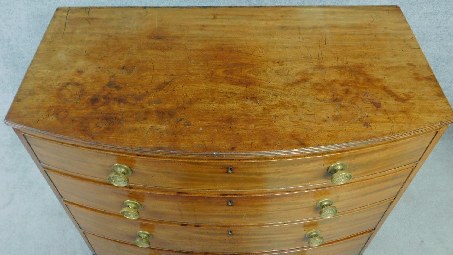 A Regency mahogany bow fronted chest of four long drawers with solid mahogany drawer linings, - Image 4 of 6