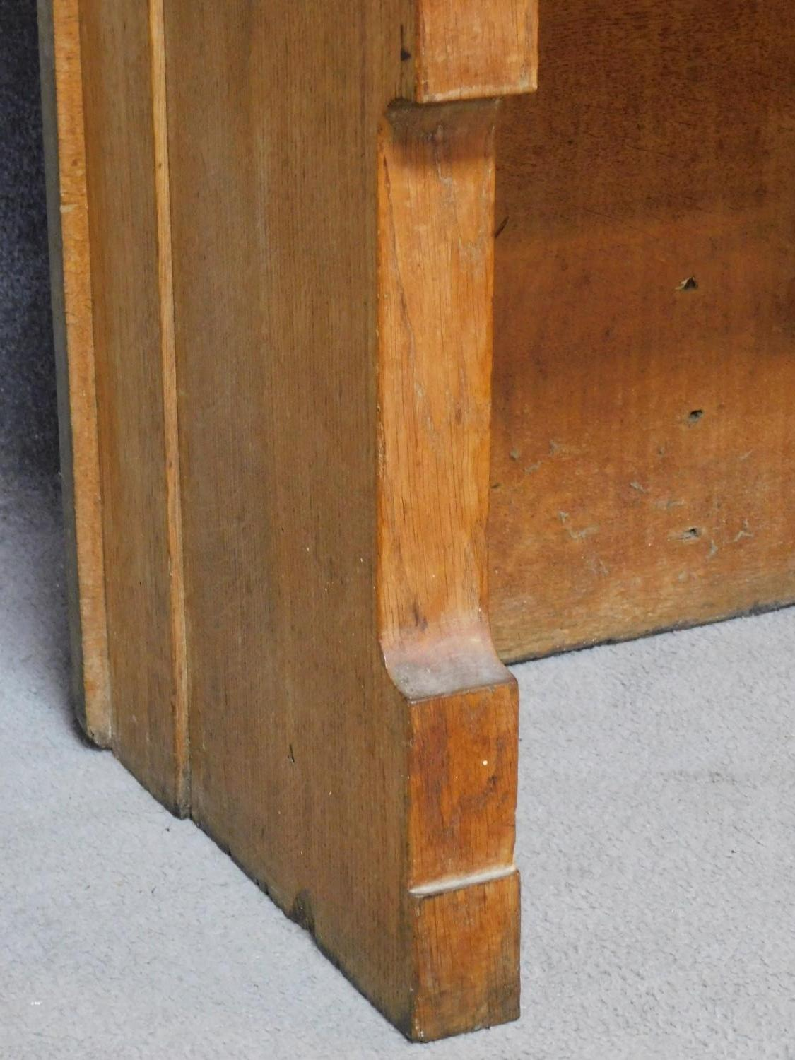 A 19th century oak hall bench with cherub carved mask above panel back on solid seat. H.169 W.75 D. - Image 6 of 7