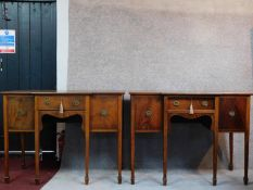A pair of 19th century mahogany sideboards with frieze drawer flanked by panel doors on square