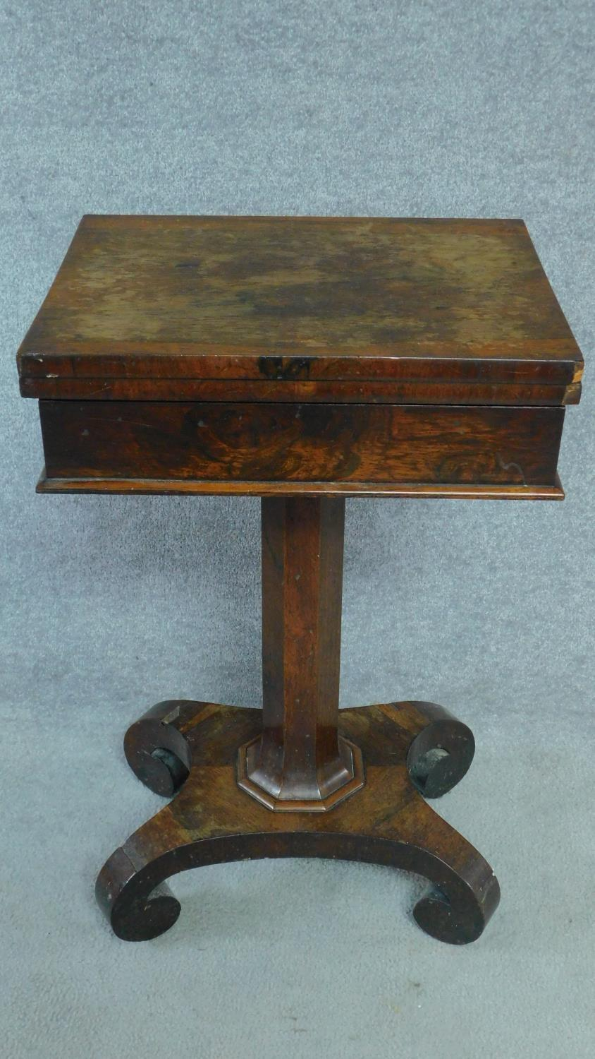 A William IV mahogany work table with fold over top enclosing interior compartment. H.73 W.71 D.46