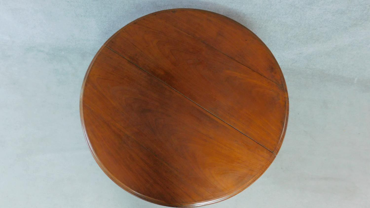 A Victorian mahogany circular dining table with tilt top action raised on carved tripod supports. - Image 3 of 7
