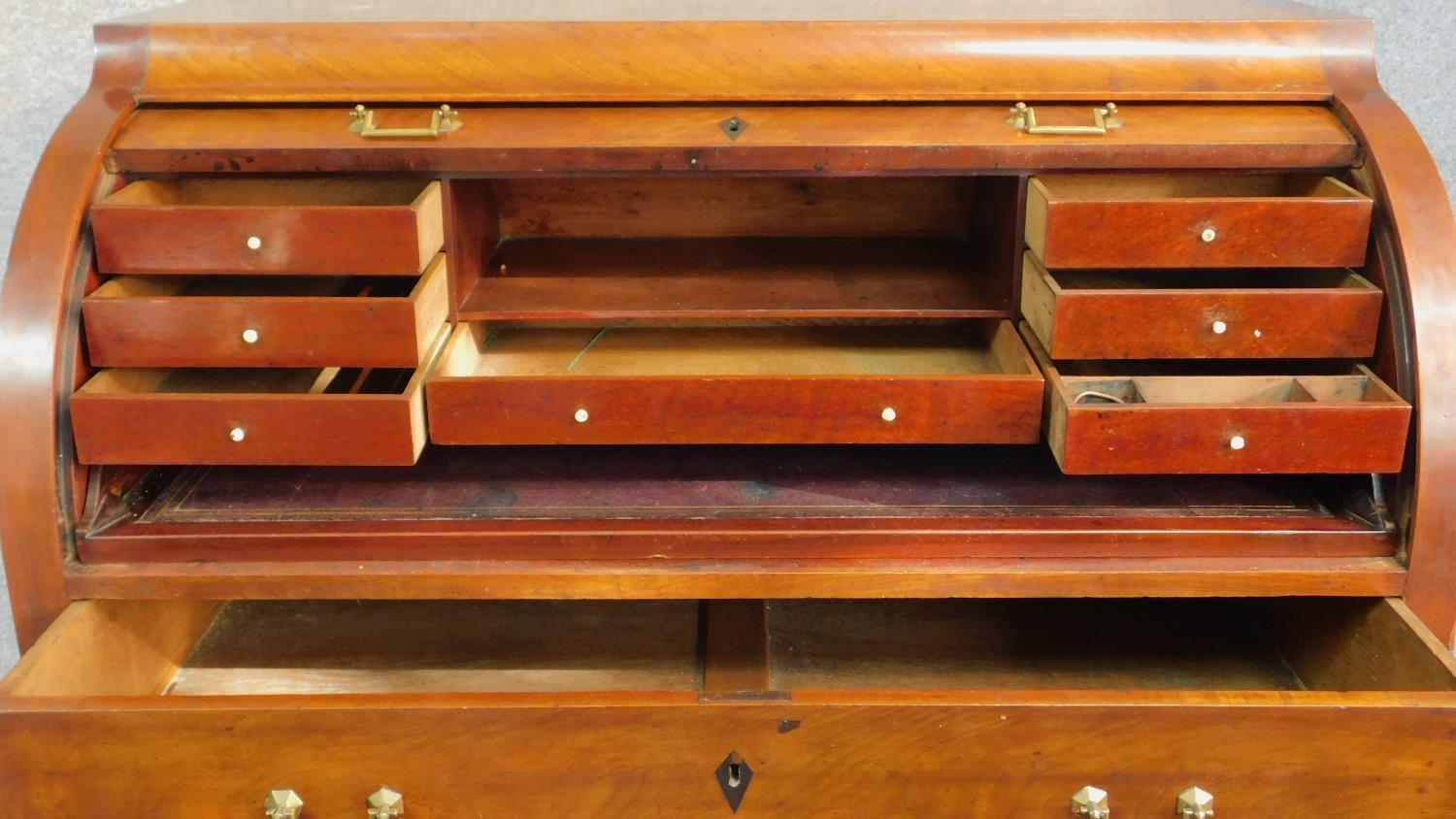 A 19th century continental mahogany cylinder top bureau with tooled leather lined slide out - Image 3 of 7