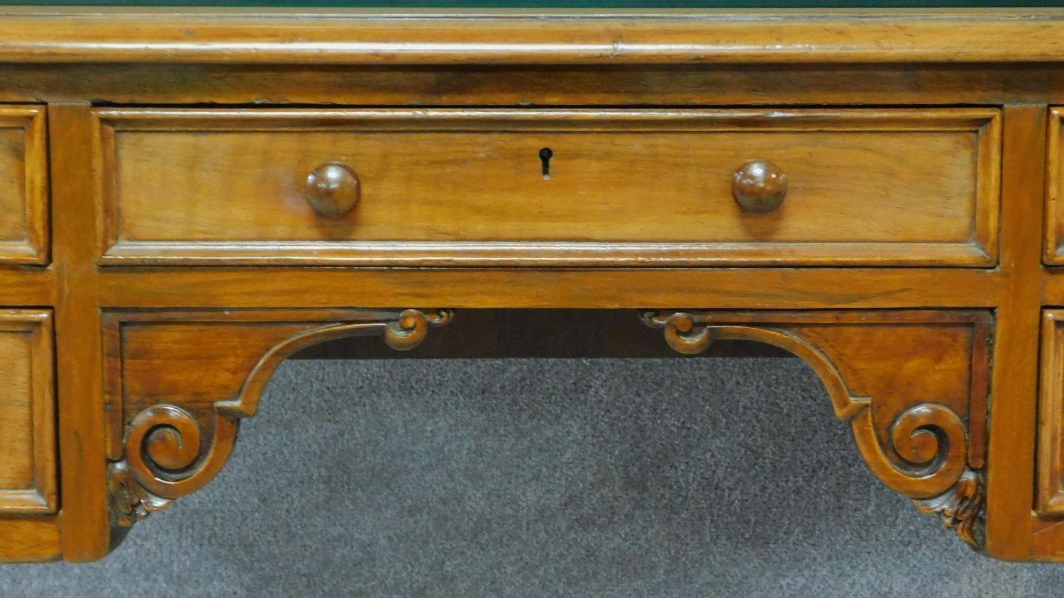 A William IV mahogany writing table with glass inset top and five frieze drawers, raised on tapering - Image 3 of 7