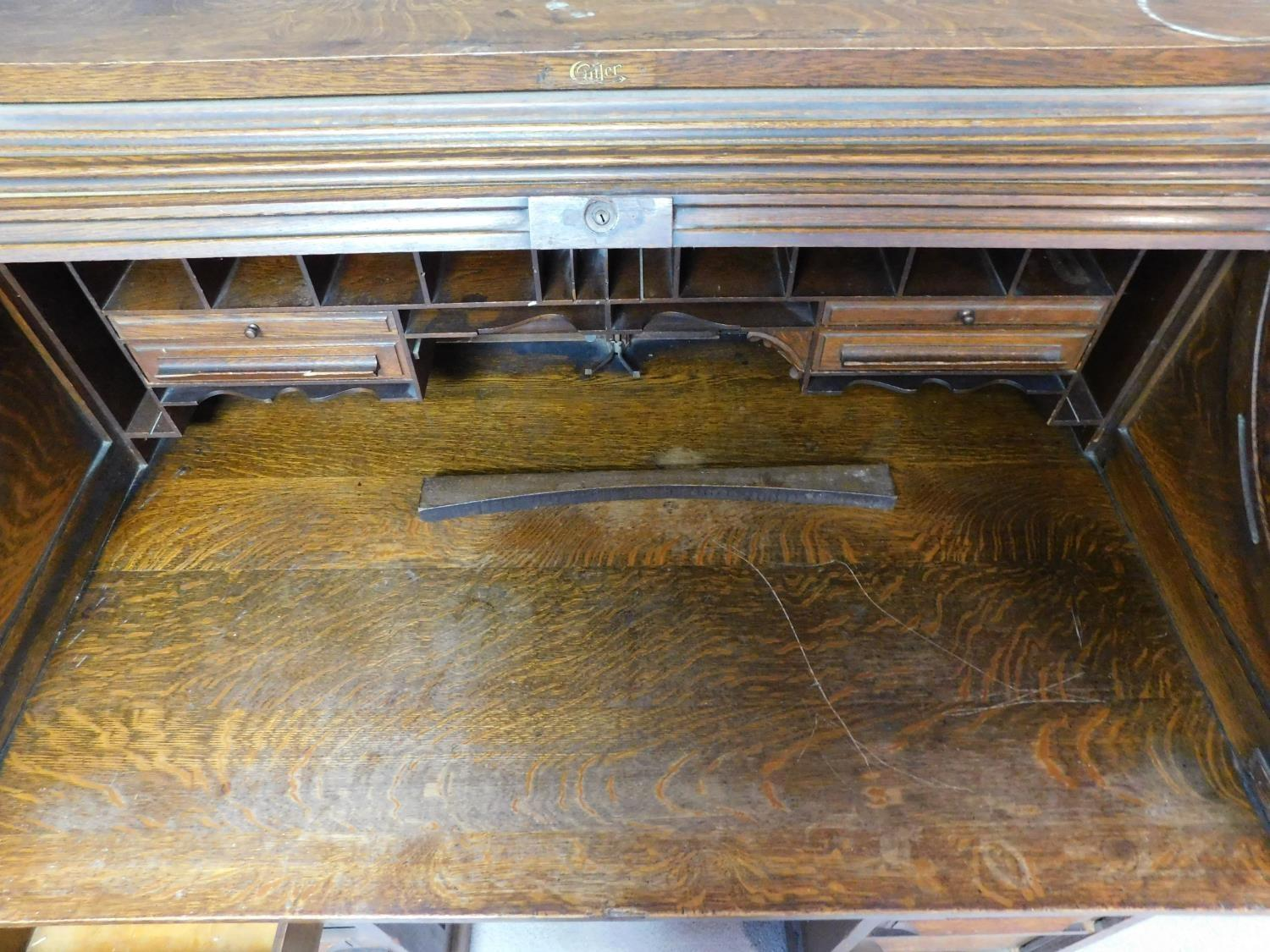 A late 19th century oak roll top desk with tambour shutter enclosing fitted interior above an - Image 6 of 9
