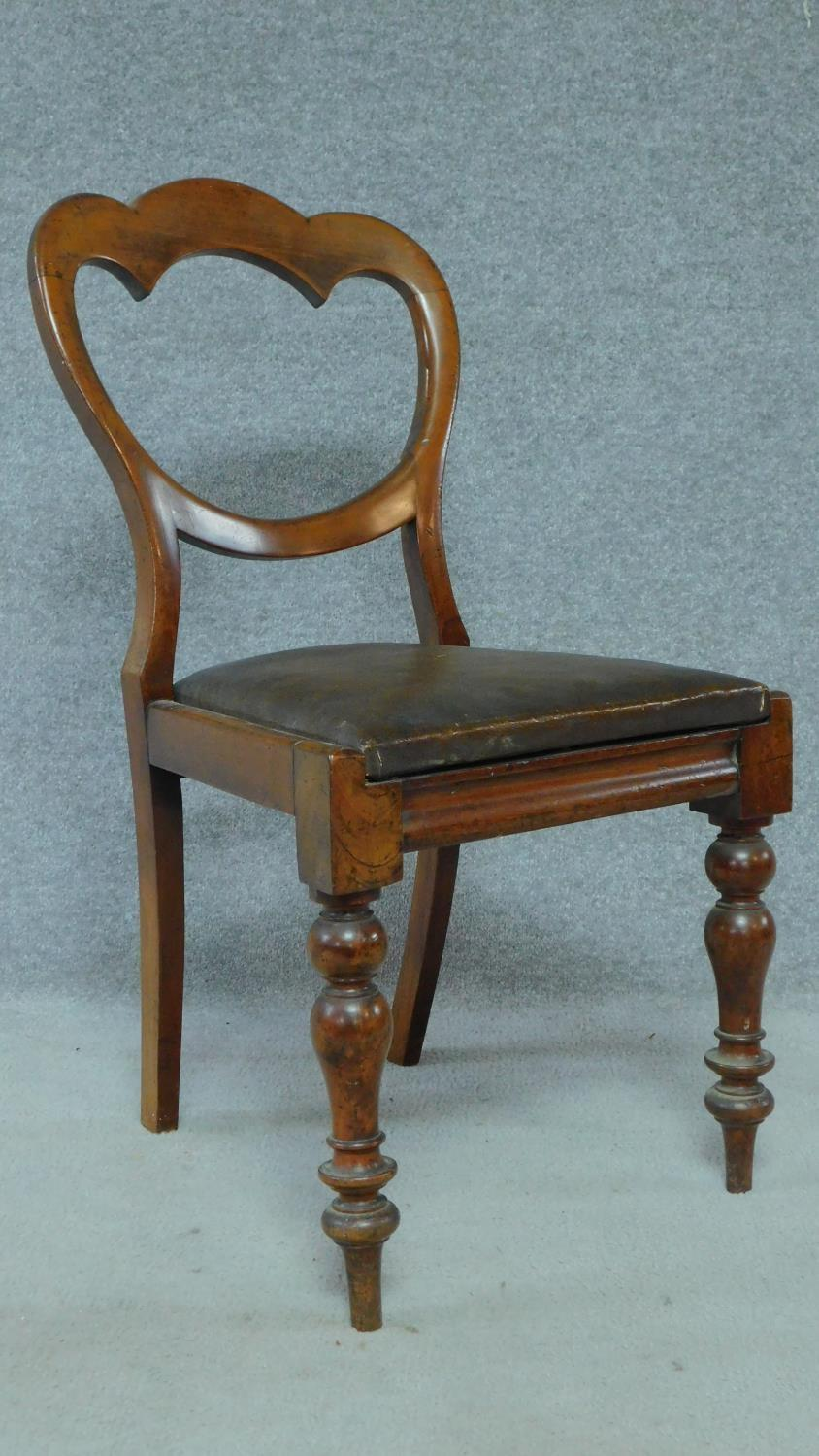 A set of six mid Victorian mahogany shaped back dining chairs raised on bulbous turned supports. - Image 3 of 7
