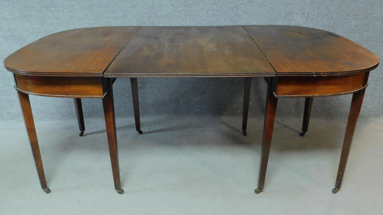 A Georgian mahogany D-end extending dining table on square tapering supports. H.76 L.181 W.55cm ( - Image 5 of 6