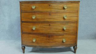 A Regency mahogany bow fronted chest of four long drawers with solid mahogany drawer linings,