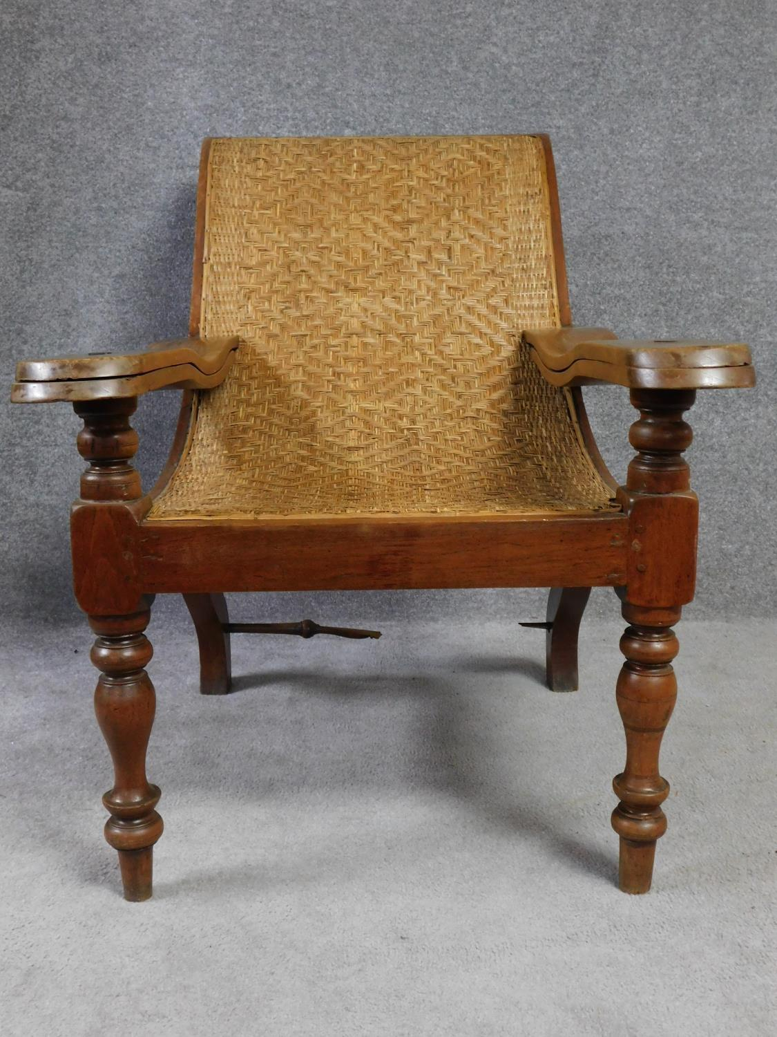A pair of Colonial teak framed reclining planter's chairs with foldout foot rests on turned tapering - Image 2 of 6