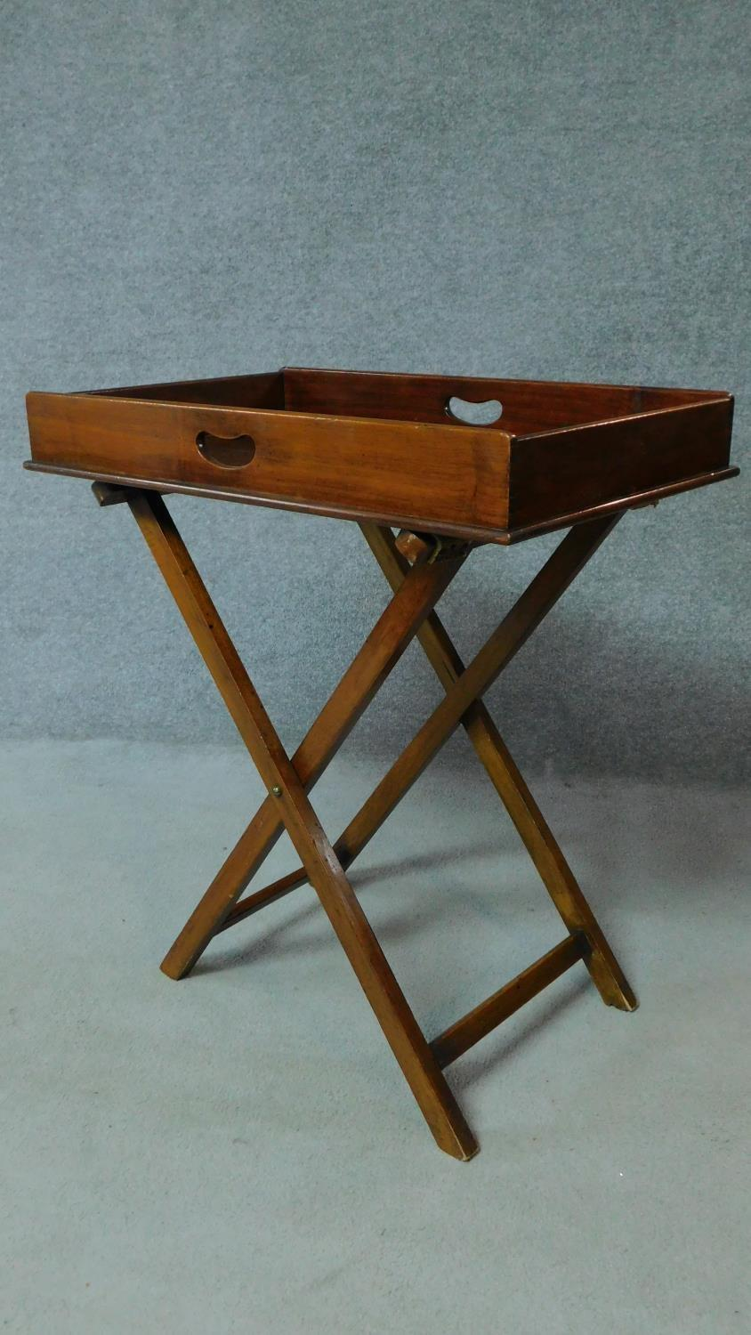 A Georgian Cuban mahogany butler's tray with folding stand. H.81 W.71 D.46cm - Image 2 of 5