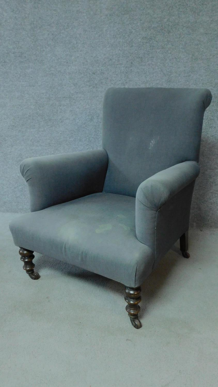A 19th century mahogany framed upholstered armchair on turned tapering supports. H.85cm
