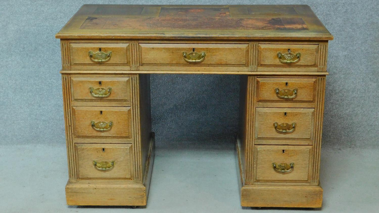 A late 19th century oak pedestal desk with leather inset top above an arrangement of nine drawers - Image 2 of 5