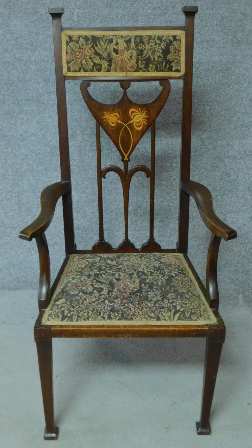 An Arts & Crafts mahogany and satinwood inlaid armchair with stylised motifs to the back splat in