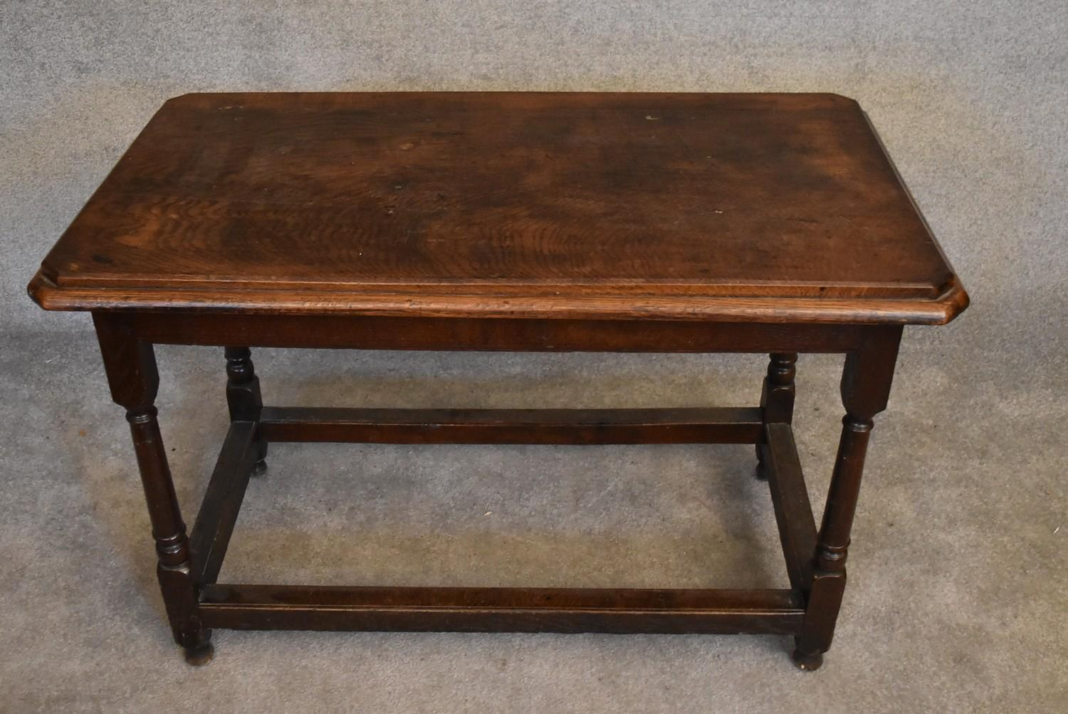 An antique oak hall or centre table on turned stretchered supports. H.76 x 112 x 63cm - Image 2 of 4