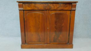 A Regency mahogany chiffonier with panel doors enclosing shelved interior on plinth base. H.90 W.103