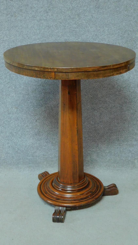 A 19th century mahogany circular occasional table raised on pedestal base. H.74 L.57 W.57cm