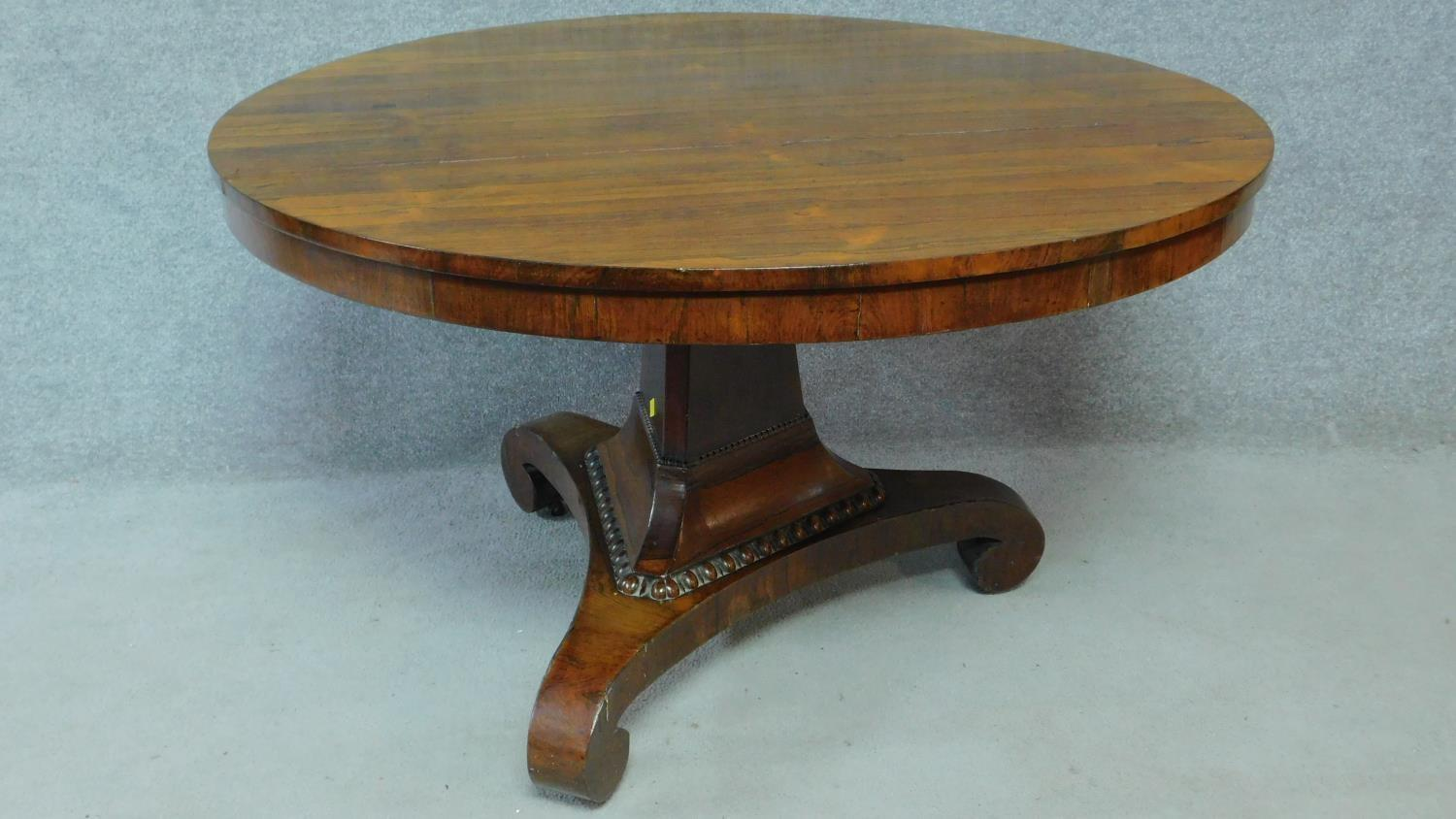 A Regency rosewood circular tilt top loo table on pedestal tripod base. H.73 L.123 W.123cm