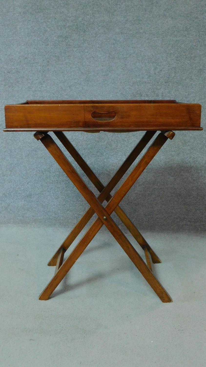 A Georgian Cuban mahogany butler's tray with folding stand. H.81 W.71 D.46cm