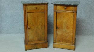 A near pair of 19th century Continental walnut bedside cabinets with grey veined marble tops and