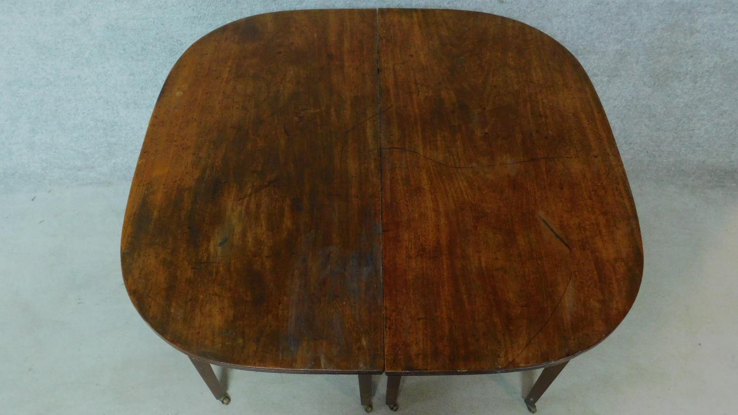 A Georgian mahogany D-end extending dining table on square tapering supports. H.76 L.181 W.55cm ( - Image 2 of 6