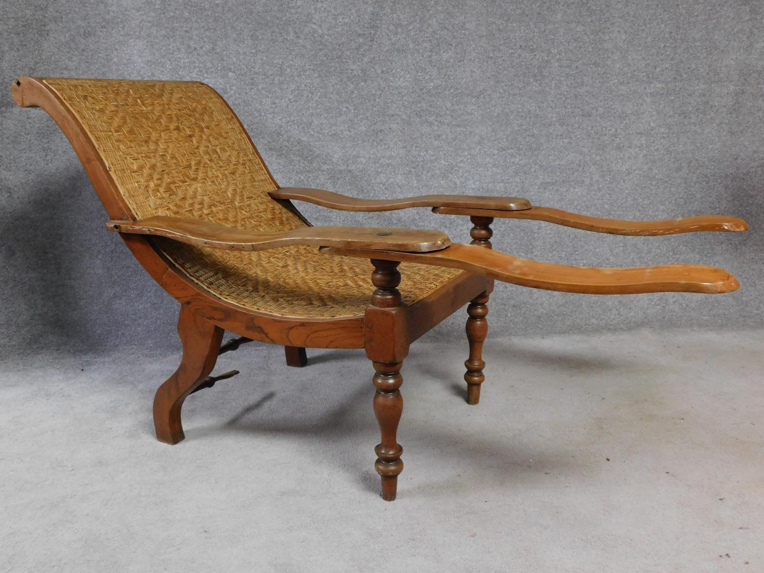 A pair of Colonial teak framed reclining planter's chairs with foldout foot rests on turned tapering - Image 3 of 6