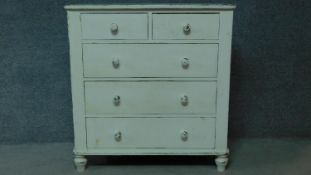 A 19th century distressed painted white chest of two short over three long drawers. H.104 W.100 D.