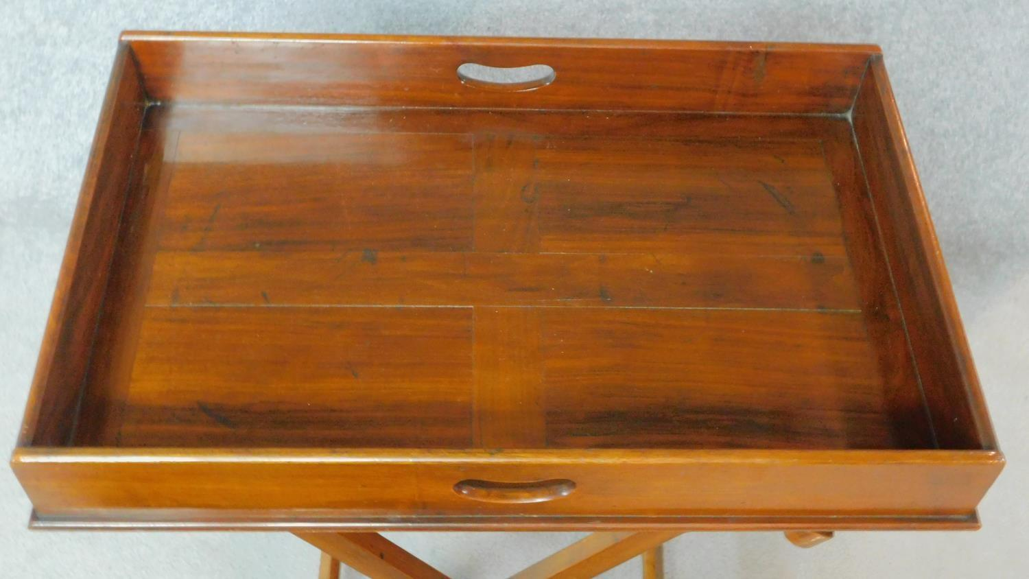 A Georgian Cuban mahogany butler's tray with folding stand. H.81 W.71 D.46cm - Image 3 of 5