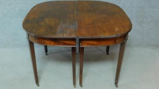 A Georgian mahogany D-end extending dining table on square tapering supports. H.76 L.181 W.55cm (