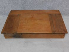 A 19th century mahogany table top clerk's writing desk. H.22 W.107 D.70cm