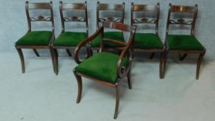 A set of five Regency mahogany dining chairs on sabre supports together with a Regency style