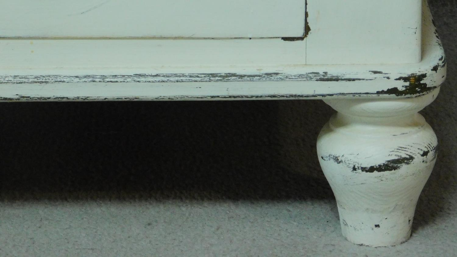 A 19th century distressed painted white chest of two short over three long drawers. H.104 W.100 D. - Image 5 of 5