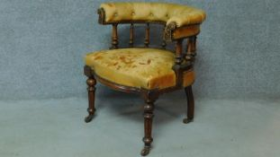 A late 19th century mahogany framed leather upholstered buttoned back library tub armchair on turned