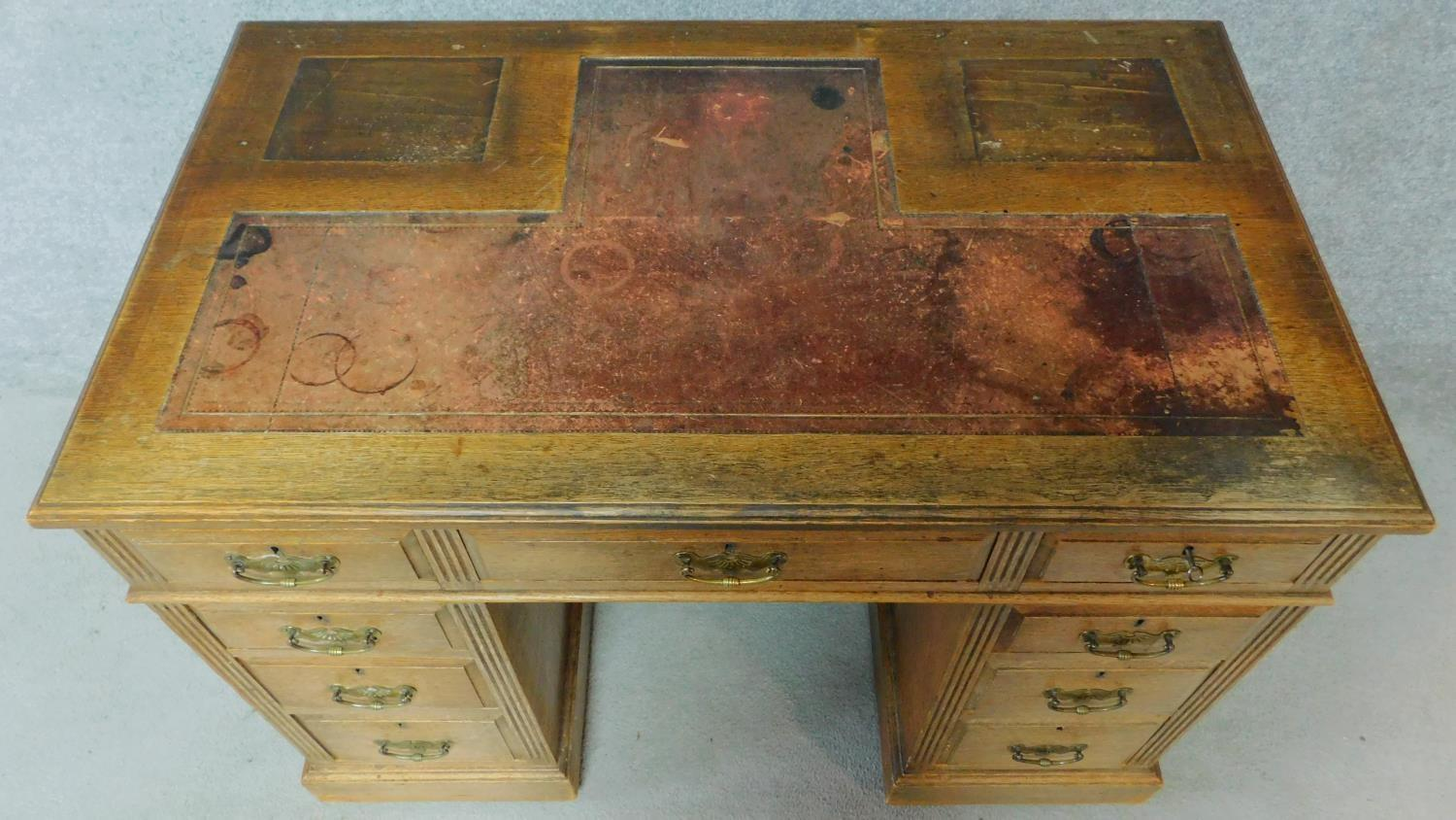 A late 19th century oak pedestal desk with leather inset top above an arrangement of nine drawers - Image 4 of 5