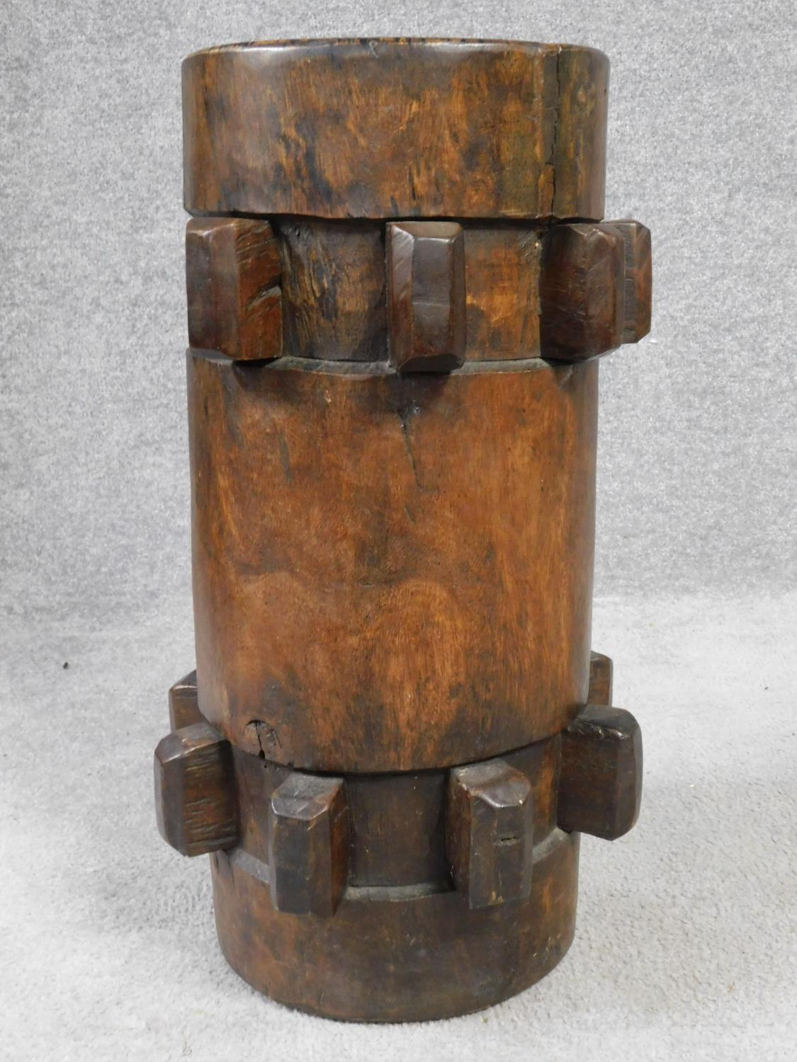 An antique hardwood stool converted from a ship's capstan. H.59 W.27cm