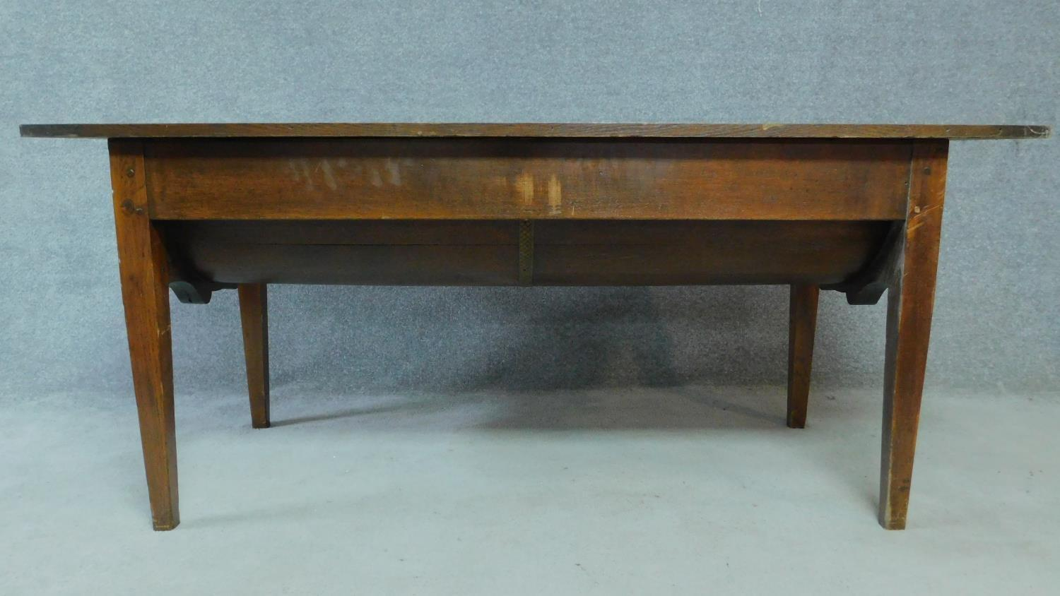 An antique oak dining table with planked lift up top and dough bin fitted to underside. H.74 W.171 - Image 2 of 5