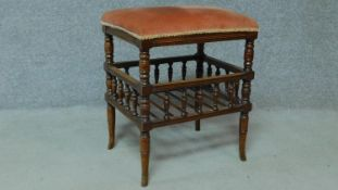 A 19th century walnut piano stool with fitted undertier for sheet music. H.55 W.46 D.36cm