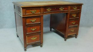 A late 19th century mahogany pedestal desk with leather inset top above an arrangement of nine