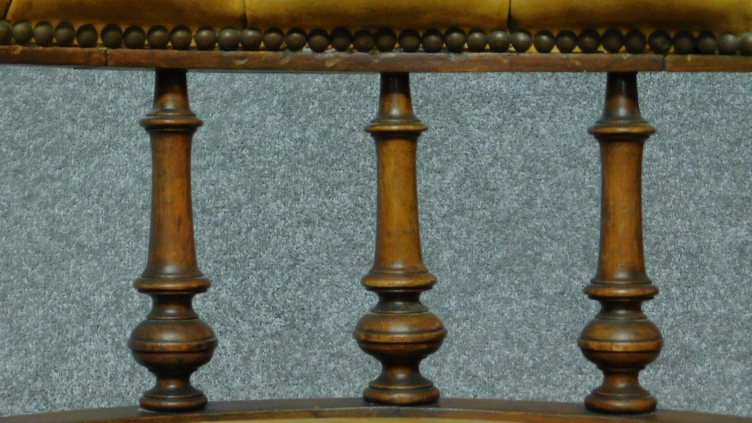 A late 19th century mahogany framed leather upholstered buttoned back library tub armchair on turned - Image 4 of 6