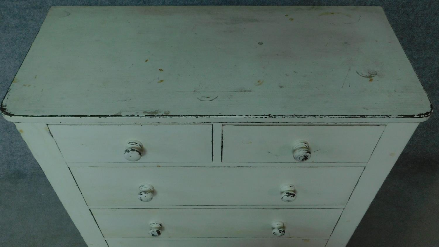 A 19th century distressed painted white chest of two short over three long drawers. H.104 W.100 D. - Image 4 of 5