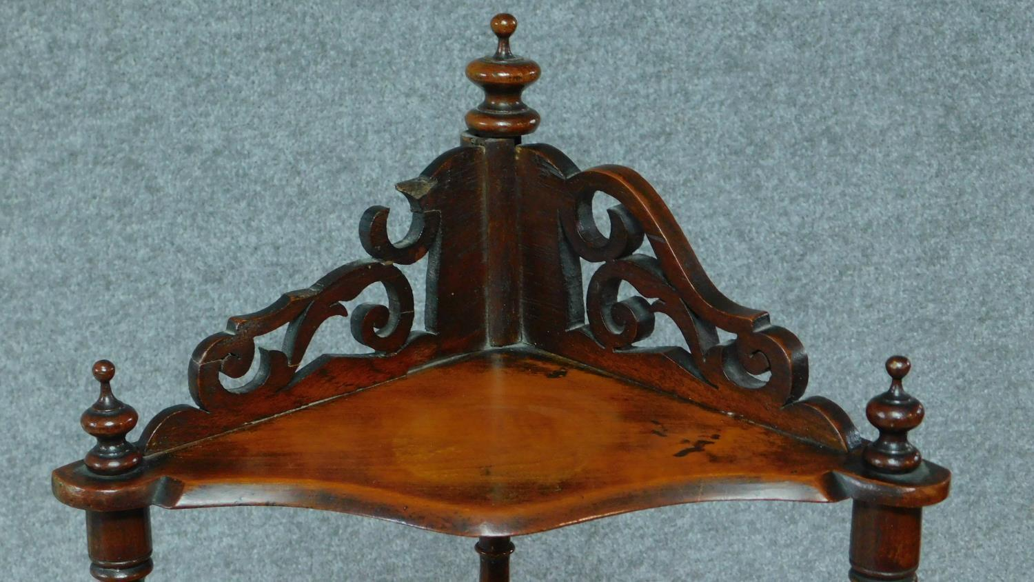 A Victorian carved walnut four tier corner whatnot. H.121cm - Image 3 of 6