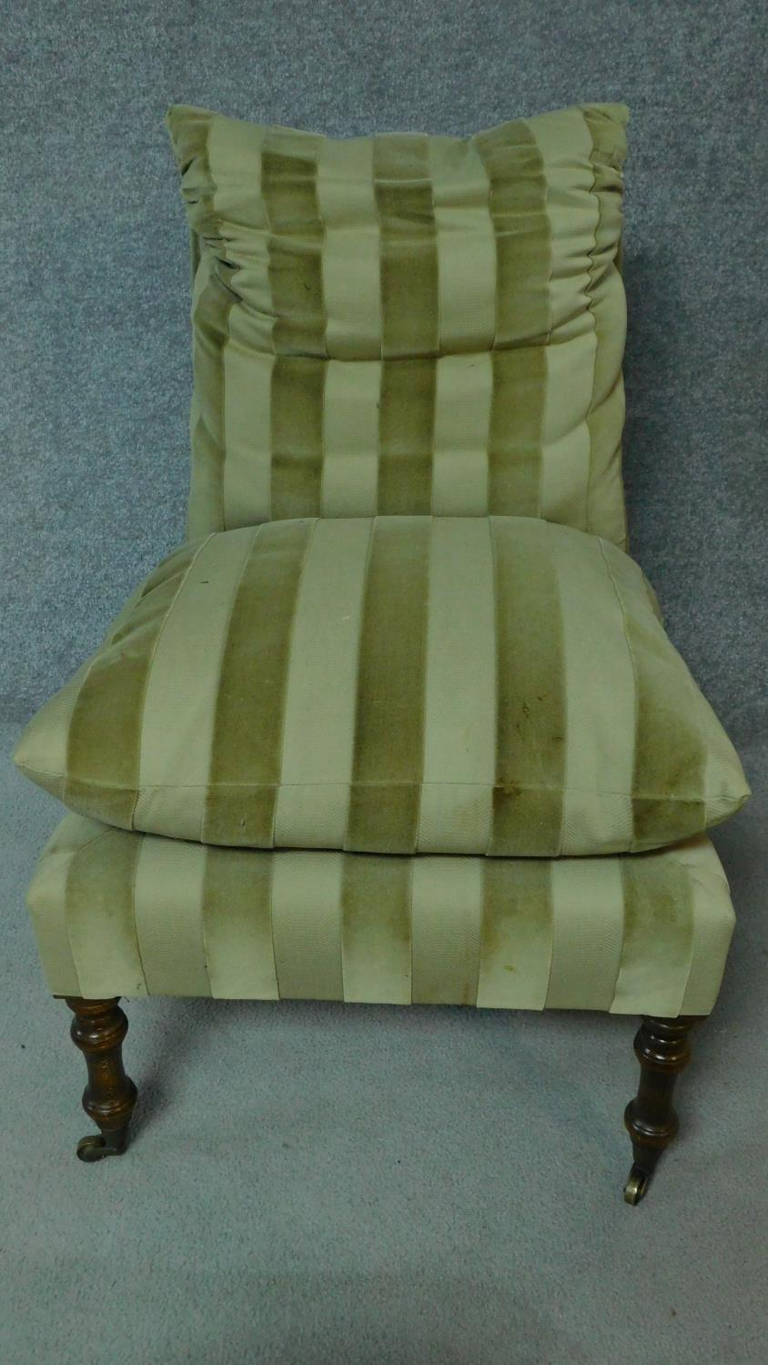 A 19th century style nursing chair in striped upholstery on turned tapering supports. H.87cm - Image 2 of 4